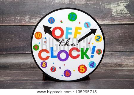 An off the clock retirement sign against a wood background