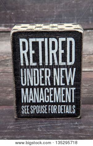 A novelty retirement sign against a wood background