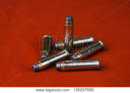 six 357 magnum bullets on red background