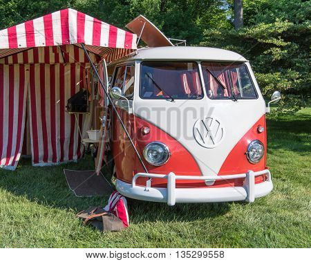 GROSSE POINTE SHORES MI/USA - JUNE 19 2016: A 1960 Volkswagen Transporter (a.k.a. Microbus) Westfalia van at the EyesOn Design car show, held at the Edsel and Eleanor Ford House, near Detroit, Michigan.