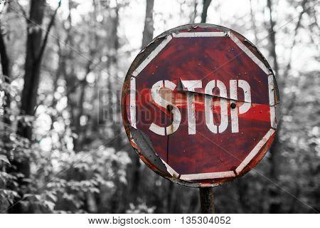 rusty stop sign in Pripyat, Chernobyl