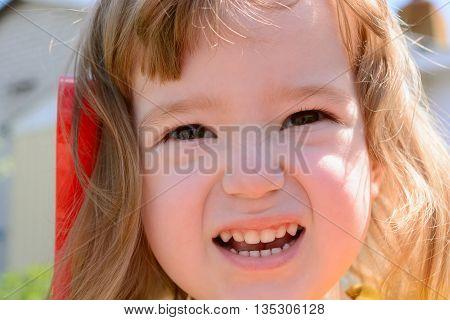 Portrait - Little Girl's Face Contorts