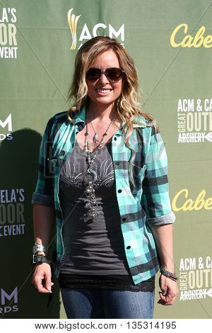 ARLINGTON, TX - APR 18: TV personality Kristy Titus attends the ACM & Cabelaâ??s Great Outdoor Archery Event at the Texas Rangers Youth Ballpark on April 18, 2015.