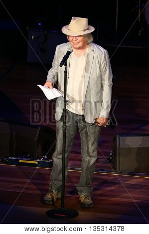 NASHVILLE, TN-SEP 1: Dan Dugmore accepts the Steel Guitar Player of the Year award during the 9th Annual ACM Honors at the Ryman Auditorium on September 1, 2015 in Nashville, Tennessee.
