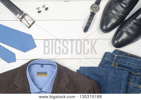 Set Of Men's Clothing And Shoes On Wooden Background. Men Accessories. Black Elegant Accessories Pie