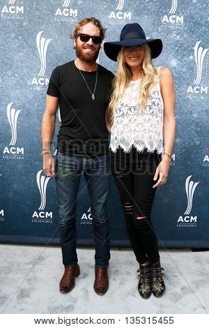 NASHVILLE, TN-SEP 1: Holly Williams (R) and husband Chris Coleman attend the 9th Annual ACM Honors at the Ryman Auditorium on September 1, 2015 in Nashville, Tennessee.