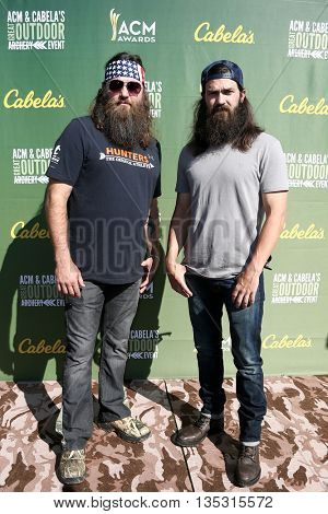 ARLINGTON, TX - APR 18: TV personalities Willie Robertson (L) and Jep Robertson attend the ACM & Cabela'??s Great Outdoor Archery Event at the Texas Rangers Youth Ballpark on April 18, 2015.