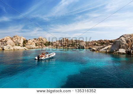 CAPRERA, SARDEGNIA/ITALY - JUNE 29 2015: Tourists in Beautiful Bay of Cala Coticcio in Caprera Island, Sardinia, Italy
