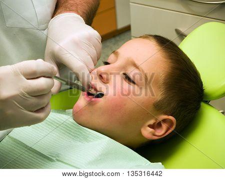 Preschool boy on dental prevention examination in hospital