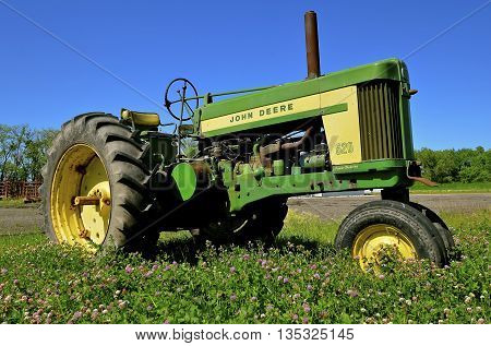 BARNESVILLE, MINNESOTA, June 19, 2016: The 630 two cylinder tractor is a product of John Deere Co, an American corporation that manufactures agricultural, construction, forestry machinery, diesel engines, and drivetrains.