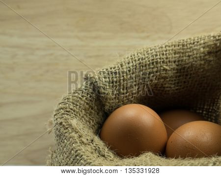 three egg in sack on wooden background.jpg