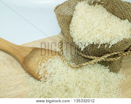rice in sack on chopping broad .