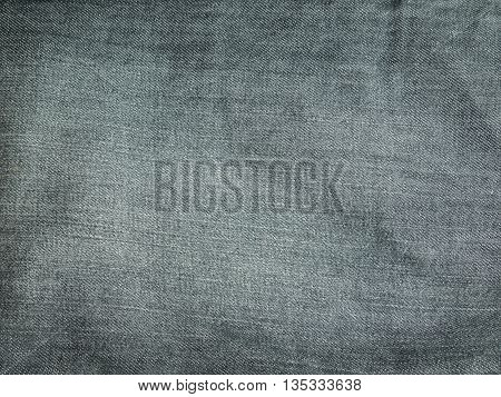 Texture of grey jeans for background .