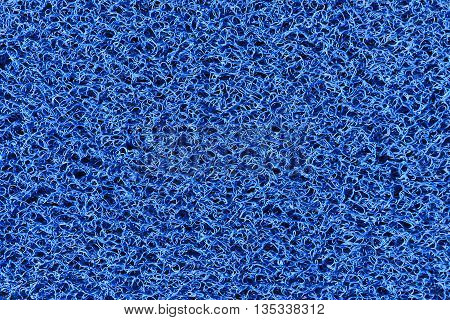 The fabric texturefabric carpet texture in close-up scene.The clean blue plastic fiber texture background.