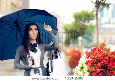 Woman Looking for a Taxi in Rainy Weather