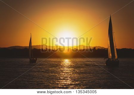 Landscape of Sailing yacht against sunset at sunset time
