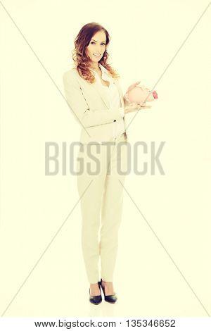 Business woman with a piggybank.