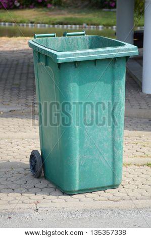 close up green plastic bin in nature garden