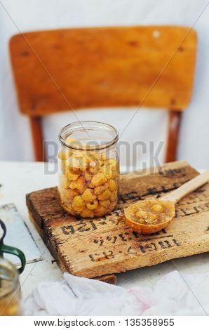 Raspberries Jam. Female Hand Making Jam, On A Rustic White Table