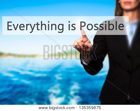 Everything Is Possible - Businesswoman Hand Pressing Button On Touch Screen Interface.