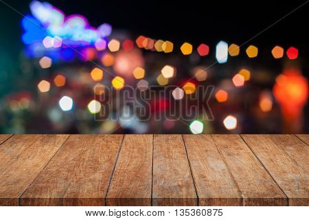 Brown wooden with abstract blurred night lights, stock photo