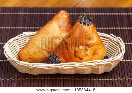 Pasties Stuffed Meat In Basket On Bamboo Napkin, Close Up