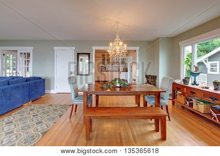 Cozy Dining Room Interior With Wooden Table And Hardwood Floor.