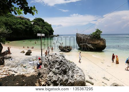 Bali, Indonesia - Feb 22, 2016: Unidentified tourist pic nic on the beautiful beach of Bali