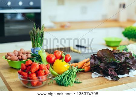 Fresh vegetables and fruit on kitchen counter