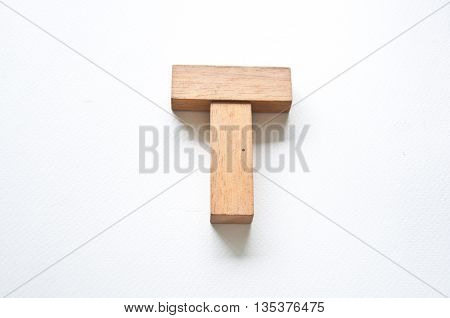 Wooden alphabet letter with drop shadow on white background T