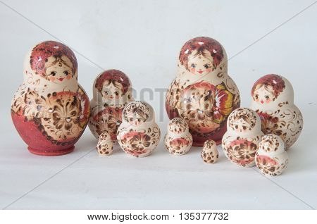 Matrioska Russian Doll side by side on white