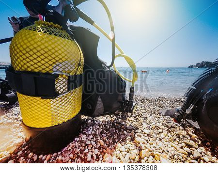Yellow diving tank prepared on the beach.