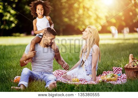 Cheerful happy family picnicking on a beautiful day