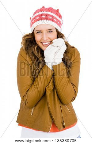 Beautiful young woman shivering on white background