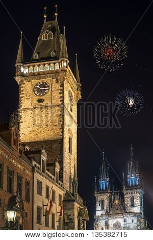 View of old town hall tower and church of Mother of God before Tyn Tyn church in Prague at night. Copy space in black sky.