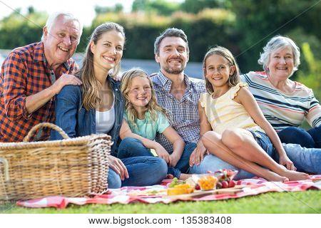 Portrait of happy multi-generation family sitting on blanket