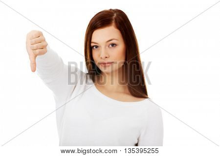 Unhappy young woman with thumbs down