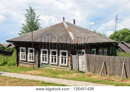 Old abandoned wooden house in russian village sunny summer day