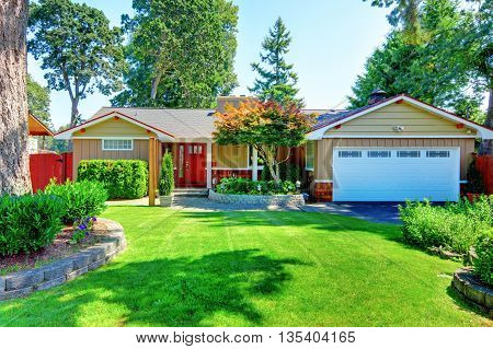 Cute Small Rambler House With Red Door And White Garage Door.