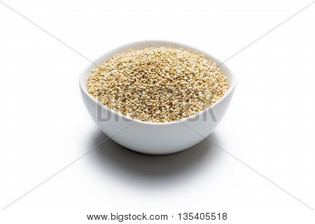 Quinoa in white bowl isolated on white background frontview.