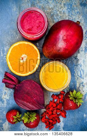 Healthy breakfast fruit smoothie with superfoods. Mango goji berry smoothie with chia seeds
