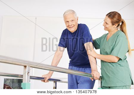 Old man in physiotherapy on treadmill with horizontal bars and physiotherapist
