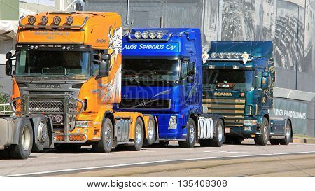 HELSINKI, FINLAND - JUNE 21, 2016: Line up of trucks near the Finnish Parliament House in Helsinki. Group of Finnish truckers protest against the new EC Cabotage rules.