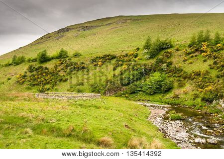 Sheepfold besides the River Coquet, which winds its way through Upper Coquetdale Valley in Northumberland