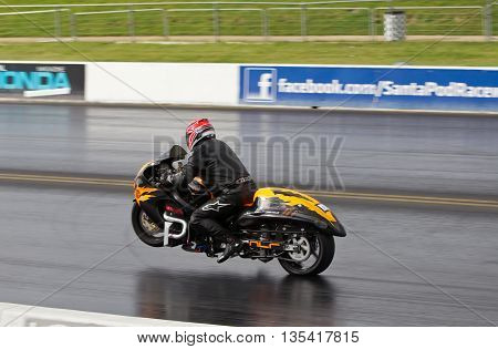 PODINGTON, UK - OCTOBER 19: An unnamed rider takes his modified Hyasbusa racing bike down the Santa Pod raceway at speed during the Extreme Performance Bike event on October 19, 2014 in Podington