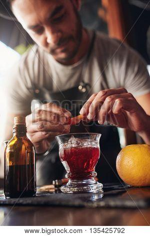 Bartender Garnishing New Negroni Cocktail