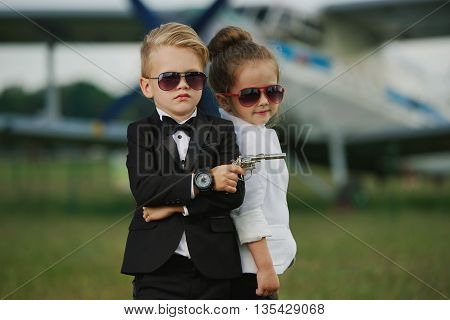 photo of young boy and girl playing spy