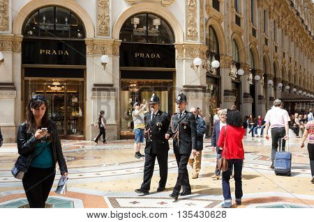 Milan Italy - May 04 2016: Police walking through the gallery Vittorio Emanuele famous shopping mall of Europe