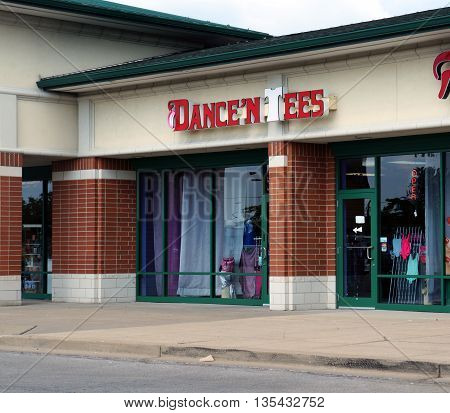 NAPERVILLE, ILLINOIS / UNITED STATES - JULY 23, 2015: One may dancing shoes and outfits at Dance 'N Tees, in a Naperville strip mall.