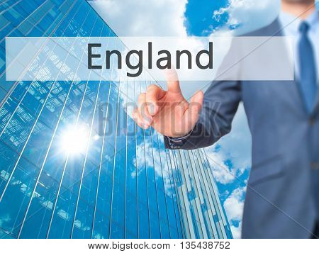 England - Businessman Hand Pressing Button On Touch Screen Interface.